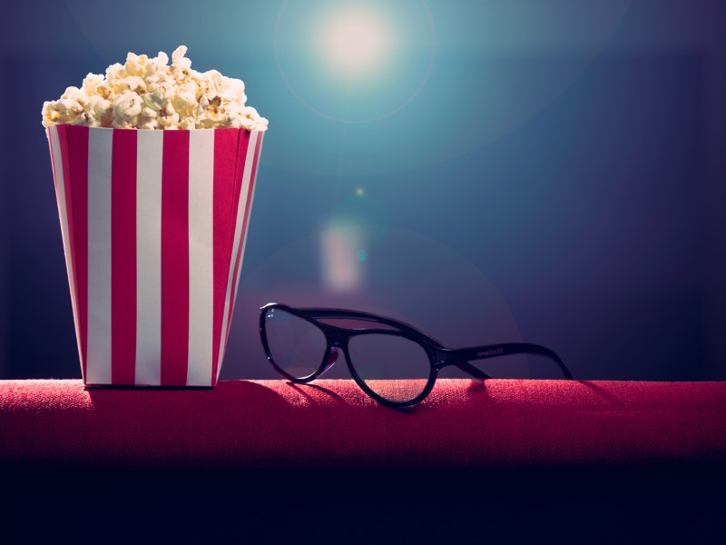 Pop corn and 3d glasses on armchair. Photo: iStock
