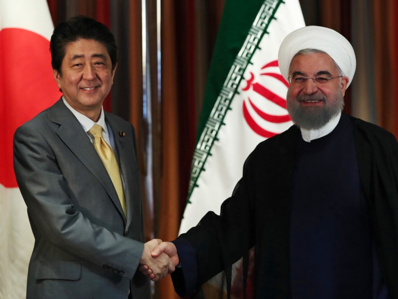 Japanese Prime Minister Shinzo Abe, left, shakes hands with Iranian President Hassan Rouhani on September 19, 2017, at a meeting in New York as world leaders gathered for the UN General Assembly. Photo: AFP/ Iranian Presidency handout
