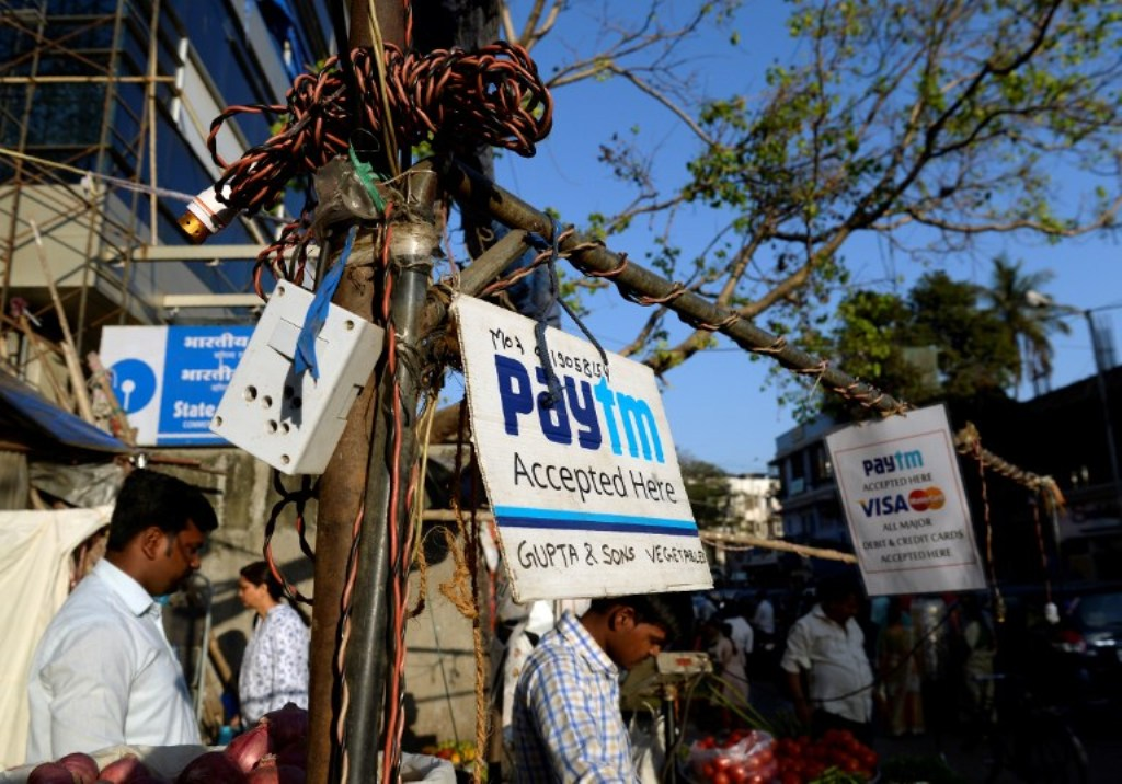 A sign advertising the mobile-phone payment system Paytm at a roadside stall in Mumbai. Photo: AFP