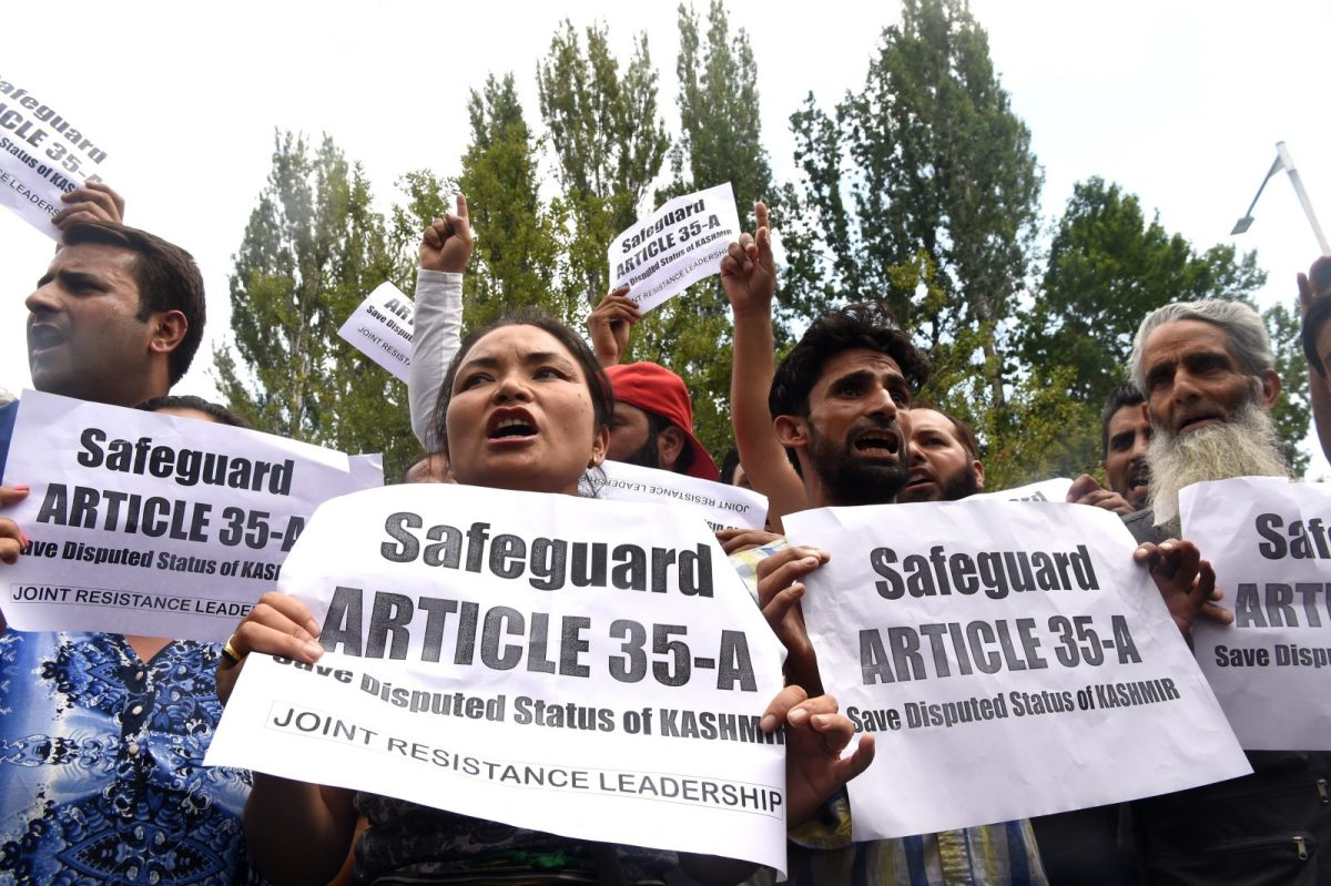 Kashmiris shout slogans during a protest against attempts to revoke articles 35A and 370 in Srinagar on August 2, 2018. Photo: AFP/Tauseef Mustafa