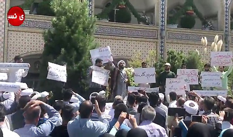 A cleric speaking on Friday to a crowd of protesters in Khorasan Razavi province, Iran. Photo: AFP