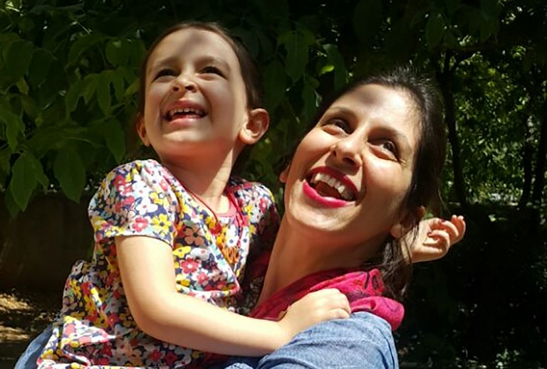 Nazanin Zaghari-Ratcliffe  embraces her daughter Gabriella following her temporary release from prison. Photo: AFP