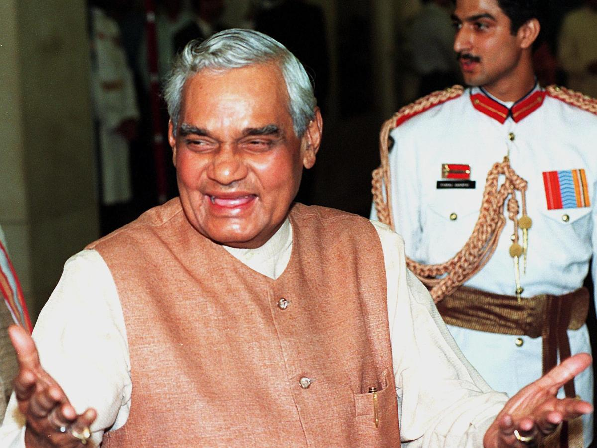Former Indian Prime Minister Atal Bihari Vajpayee gestures at the presidential palace in New Delhi on August 15, 1998, after addressing the nation on India's 50th anniversary of independence. In his speech he said he was ready for talks with Pakistan ''on any issue, at any time, at any level and anywhere in the world.'' Photo: AFP