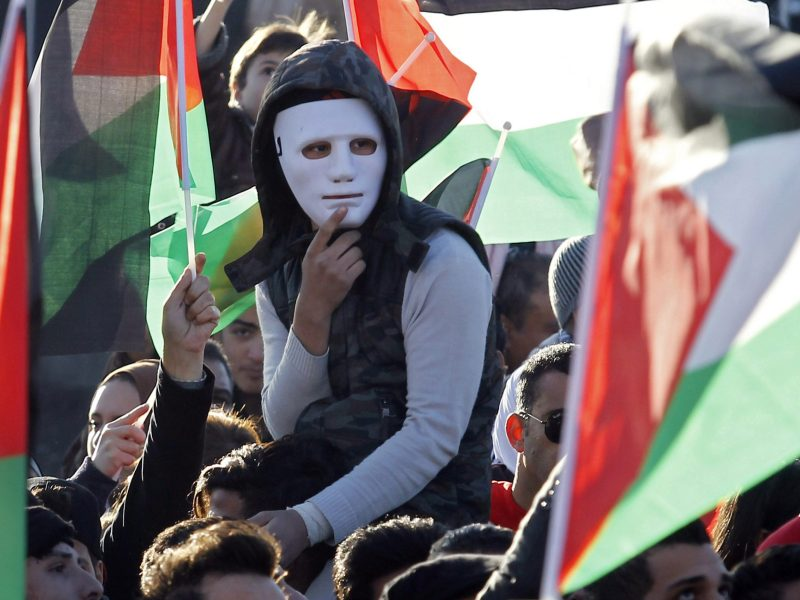 Protesters shout slogans and wave Palestinian flags during a demonstration against the US president's decision to recognize Jerusalem as the capital of Israel, near the American embassy in Amman. Photo: AFP/Ahmad Abdo
