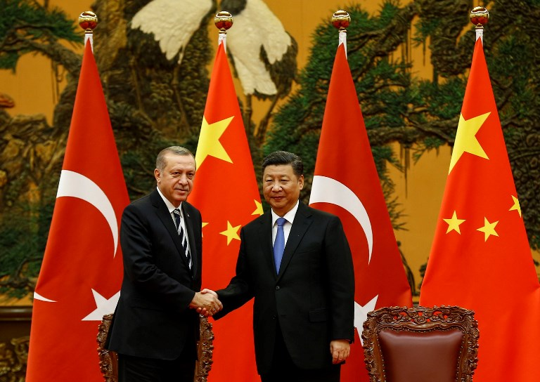 Turkish President Recep Tayyip Erdogan and Chinese President Xi Jinping shake hands in Beijing last year. Photo: AFP/Anadolu Agency