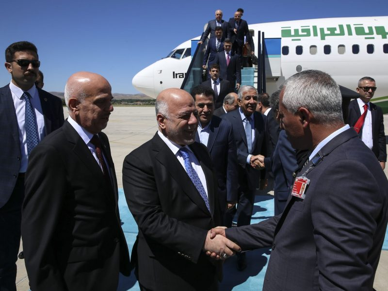 Iraqi Prime Minister Haider al-Abadi (C) is welcomed by officials upon his arrival in Ankara, Turkey on August 14, 2018. The Iraqi leader over the weekend canceled a scheduled visit to Tehran after announcing his government would adhere to US sanctions on Iran. Photo: Anadolu Agency/Muhammed Selim Korkutata