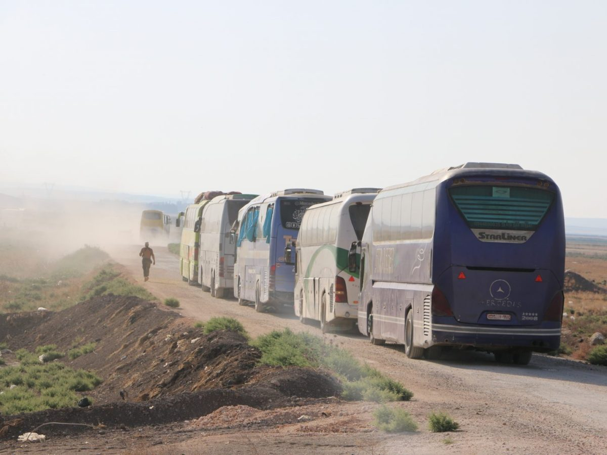 Buses depart as civilians are evacuated from the Shiite villages of Fuaa and Kafraya in Syria's northwestern Idlib province after a deal was reached last month between Iran and Syrian opposition groups. Photo: AFP/ Ahmed Rahhal / Anadolu Agency
