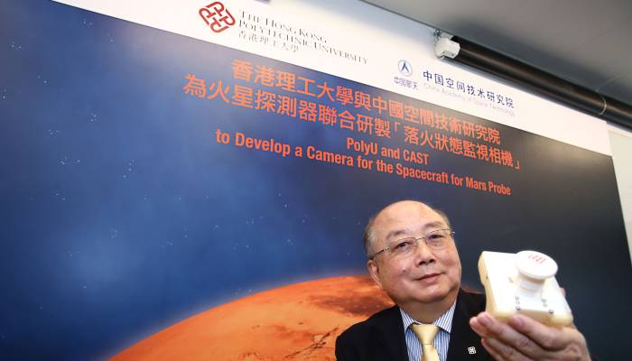 PolyU Professor Yung Kai-leung shows a model of the camera to be fitted on China's first Mars probe. Photo: Handout