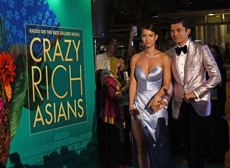 Actor Henry Golding and his wife Liv Lo arrive at the premiere of 'Crazy Rich Asians' at the Capitol Theatre in Singapore on August 21, 2018. Photo: AFP / Roslan Rahman