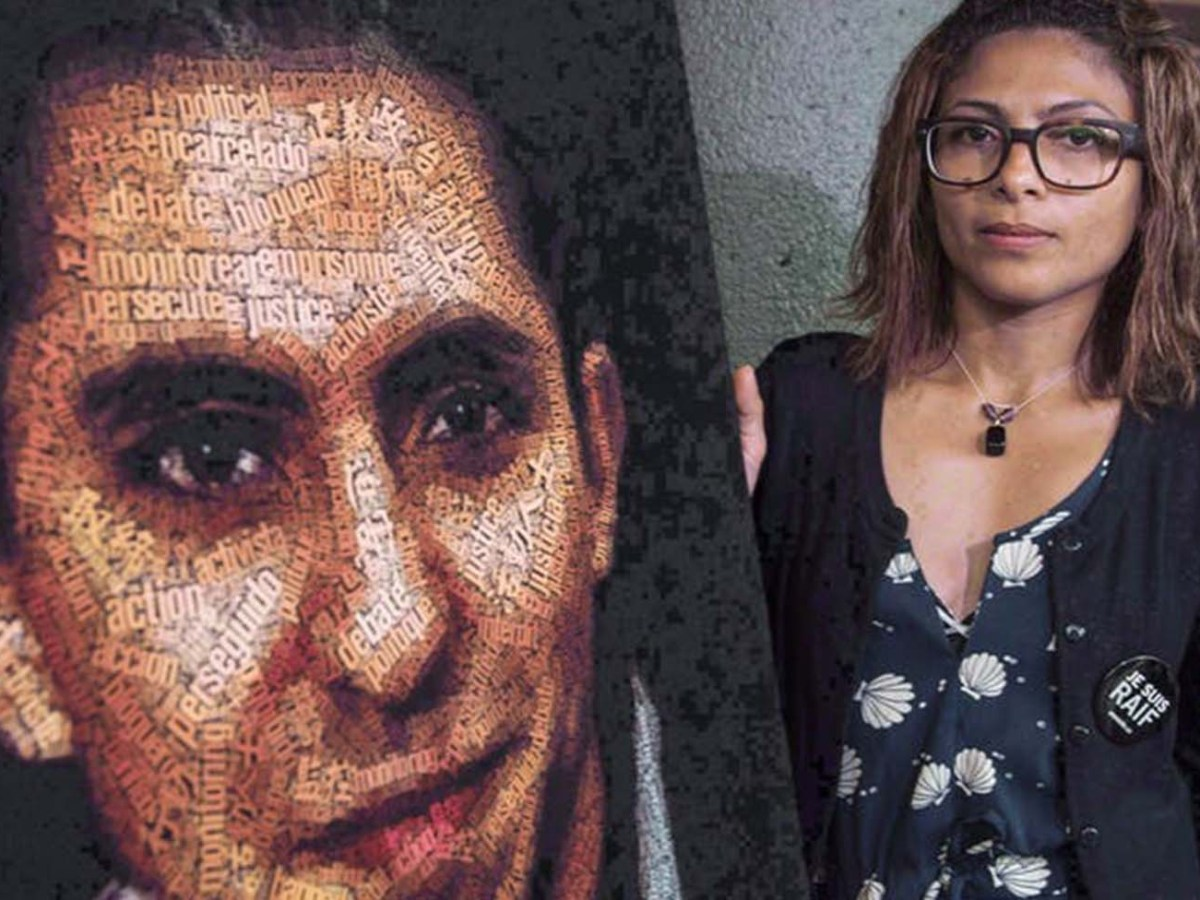 Ensaf Haidar stands next to a poster of her husband, jailed blogger Raif Badawi, in Montreal in June 2015. The arrest of Badawi's sister, Samar, is at the centre of a bitter spat between Canada and Saudi Arabia. Photo: CP/Paul Chiasson