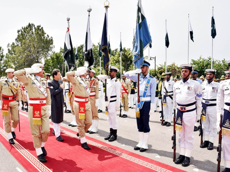 Pakistani Prime Minister Imran Khan inspects a guard of honor on his arrival at Prime Minister House in Islamabad. He was sworn in at a ceremony on August 18. Photo: AFP / Govt handout
