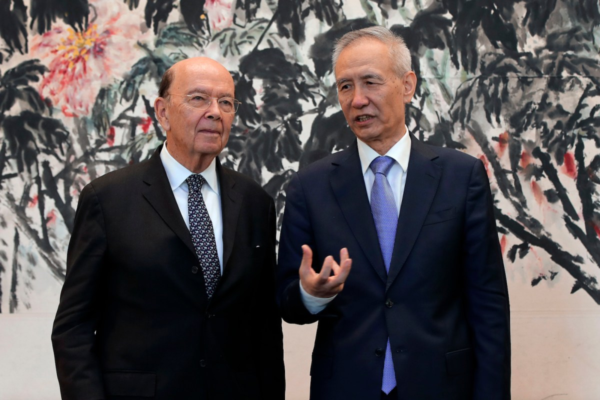 US Commerce Secretary Wilbur Ross, left, chats with Chinese Vice-Premier Liu He during 'trade dispute' talks in Beijing earlier this year. Some sort of agreement could be reached at the G20 summit. Photo: AFP / Andy Wong