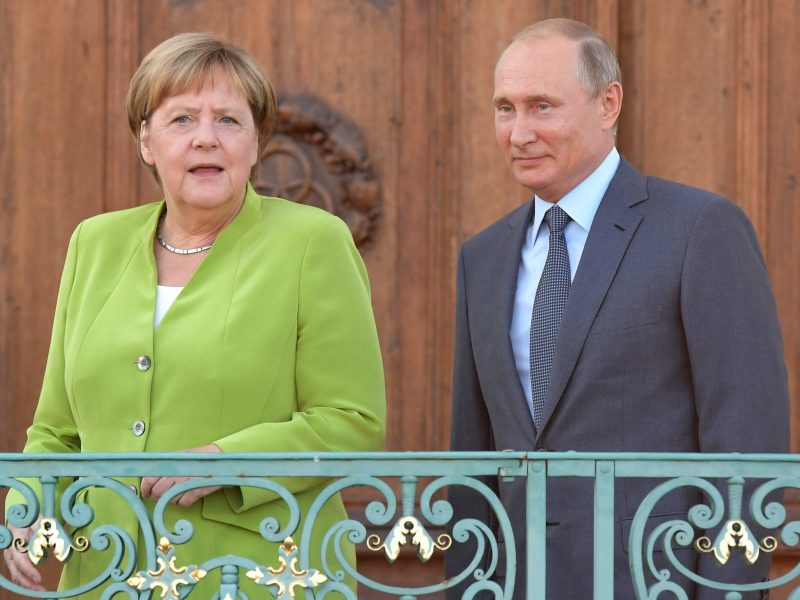 Russian President Vladimir Putin and German Chancellor Angela Merkel take to the stage during a meeting at the German government guesthouse in Meseberg. Photo: AFP/Sergey Guneev/Sputnik