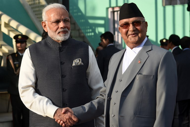 Nepali Prime Minister KP Sharma Oli, right, greets Indian PM Narendra Modi during a guard of honor in Kathmandu. Nepali intelligence officials have been key allies for India in counter-terror work. Photo: AFP / Ashok Dulal