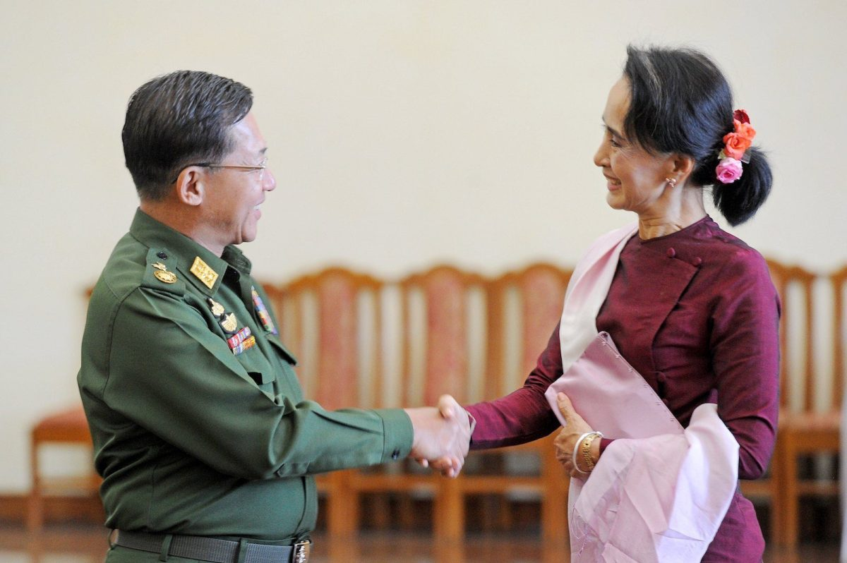 Senior General Min Aung Hlaing, Myanmar Commander In-Chief (L) and National League for Democracy (NLD) party leader Aung San Suu Kyi (R) shake hands after their meeting in Naypyidaw in a file photo. Photo: AFP/ Phyo Hein Kyaw