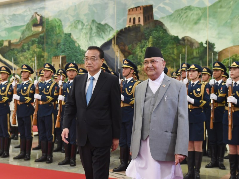 Nepali Prime Minister K.P. Sharma Oli (right) reviews a military honor guard with Chinese Premier Li Keqiang during a welcome ceremony at the Great Hall of the People in Beijing on June 21, 2018. Photo: AFP/Greg Baker