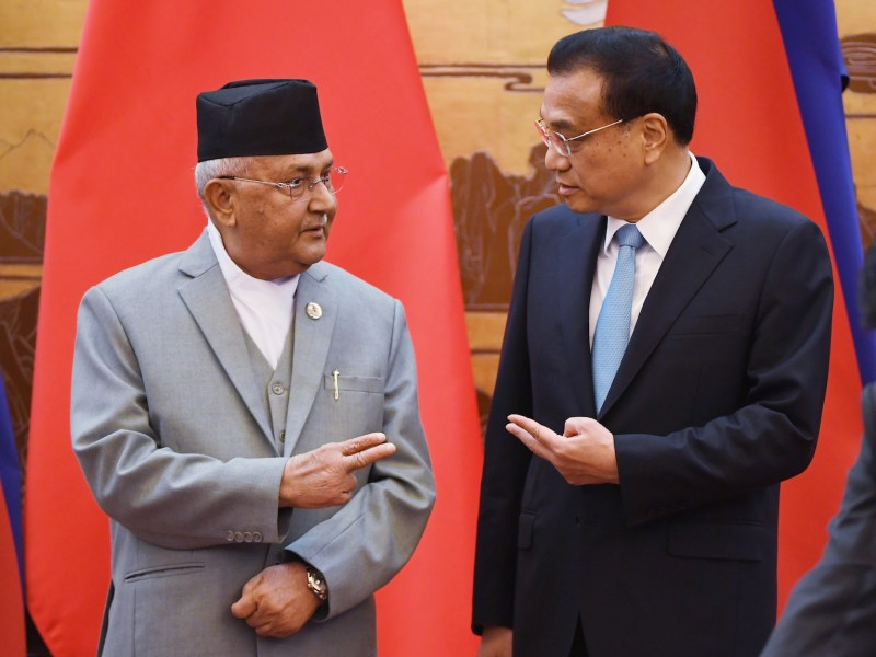 Nepal's Prime Minister K.P. Sharma Oli (L) chats with Chinese Premier Li Keqiang during a signing ceremony at the Great Hall of the People in Beijing on June 21, 2018. / AFP PHOTO / POOL / GREG BAKER / ìThe erroneous mention[s] appearing in the metadata of this photo by GREG BAKER has been modified in AFP systems in the following manner: [chats with Chinese Premier Li Keqiang during a signing ceremony] instead of [reviews a military honour guard with Li Keqiang during a welcome ceremony]. Please immediately remove the erroneous mention[s] from all your online services and delete it (them) from your servers. If you have been authorized by AFP to distribute it (them) to third parties, please ensure that the same actions are carried out by them. Failure to promptly comply with these instructions will entail liability on your part for any continued or post notification usage. Therefore we thank you very much for all your attention and prompt action. We are sorry for the inconvenience this notification may cause and remain at your disposal for any further information you may require.î