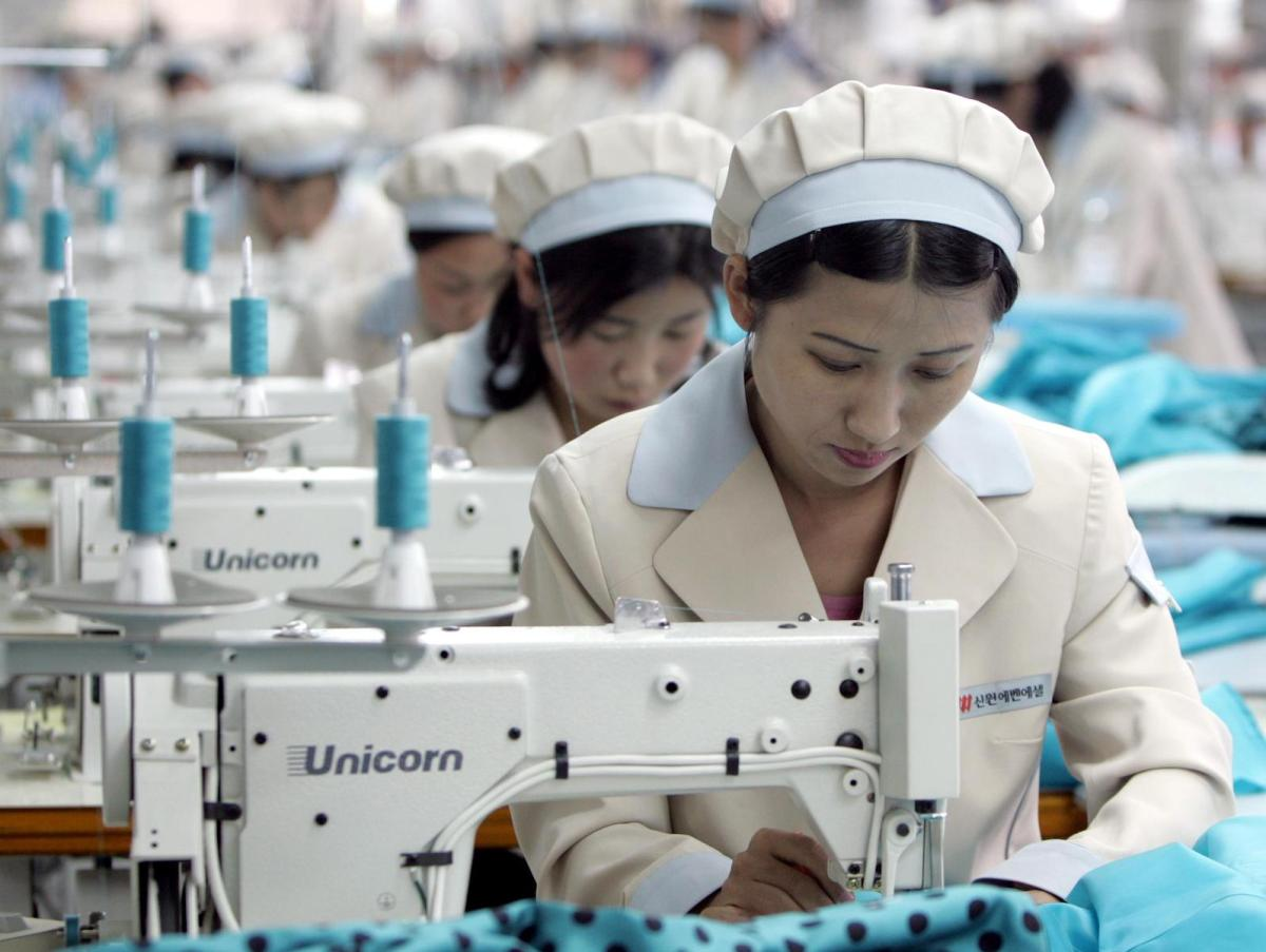 North Korean workers work at a factory of South Korean apparel maker Shinwon in a file photo Photo: AFP/Lee Jae-won