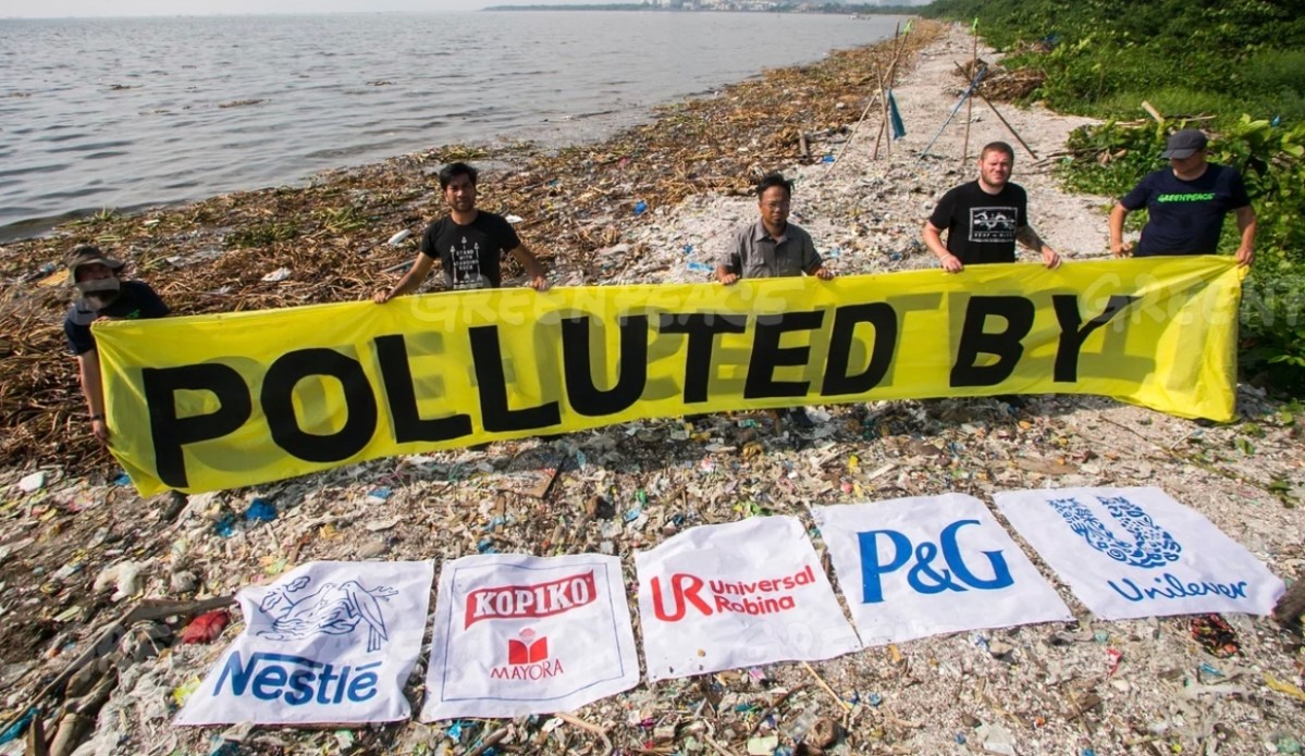 Greenpeace activists campaigning against multinational companies for their plastic pollution. Photo: Greenpeace
