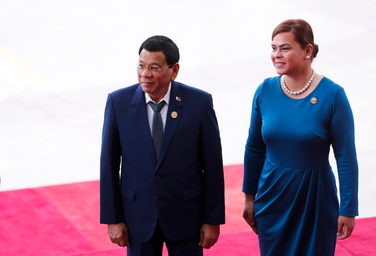 Philippine President Rodrigo Duterte (L) and his daughter Sara Duterte arrive for the opening of the Boao Forum for Asia (BFA) Annual Conference 2018 in Boao, south China's Hainan province on April 10, 2018. The BFA annual conference 2018 takes place between April 8-11. / AFP PHOTO / - / China OUT / ìThe erroneous mention[s] appearing in the metadata of this photo by - has been modified in AFP systems in the following manner: [daughter Sara Duterte] instead of [wife Honeylet Avancena]. Please immediately remove the erroneous mention[s] from all your online services and delete it (them) from your servers. If you have been authorized by AFP to distribute it (them) to third parties, please ensure that the same actions are carried out by them. Failure to promptly comply with these instructions will entail liability on your part for any continued or post notification usage. Therefore we thank you very much for all your attention and prompt action. We are sorry for the inconvenience this notification may cause and remain at your disposal for any further information you may require.î