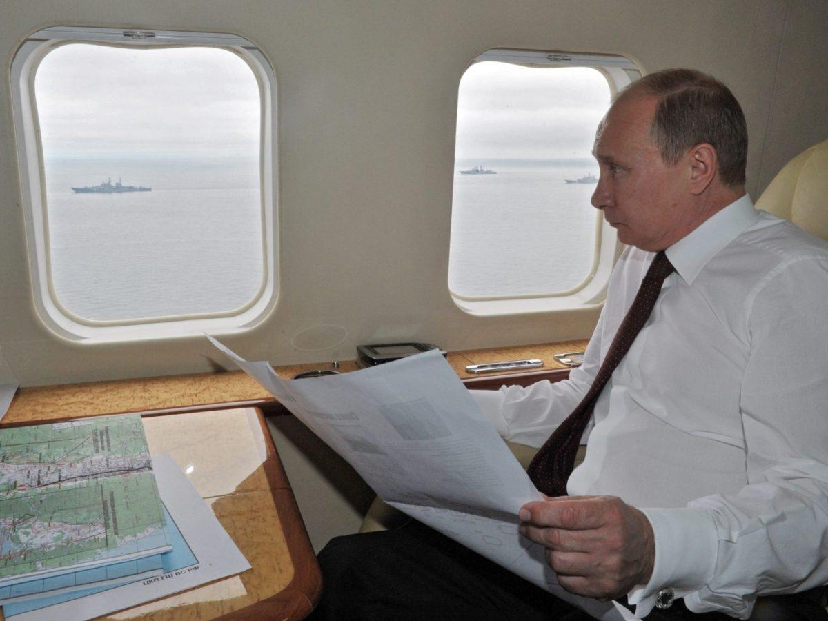 Vladimir Putin inspects military exercises in the Pacific Ocean near Sakhalin island on July 16, 2013. Photo: AFP/Ria-Novosti/Alexei Nikolsky