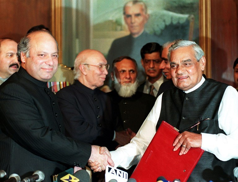Pakistani prime minister Nawaz Sharif (left) shakes hands with his Indian counterpart Atal Bihari Vajpayee after signing an agreement named as the Lahore Declaration at Governor House in Lahore on February 21, 1999.          Photo: AFP / Saeed Khan