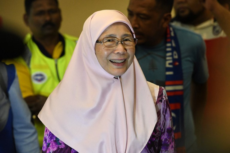 Justice Party president Wan Azizah smiles after visiting her husband, jailed former opposition leader Anwar Ibrahim, at the Cheras Rehabilitation Centre hospital in Kuala Lumpur on May 11, 2018.   Photo: AFP / Roslan Rahman