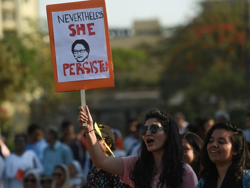 Pakistani civil society activists carry placards as the march during a rally to mark International Women's Day in Karachi on March 8, 2018. / AFP PHOTO / ASIF HASSAN