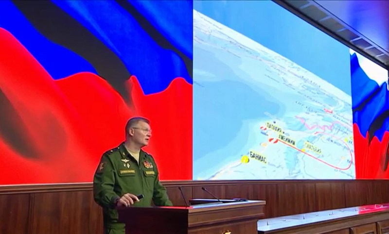 Russian Defense Ministry spokesman Maj. Gen. Igor Konashenkov speaks to the media next to a graphic of an incident in which a Russian warplane was shot down by a Syrian air defense unit last week. Photo:  Grab from video released by Defense Ministry / Sputnik /AFP