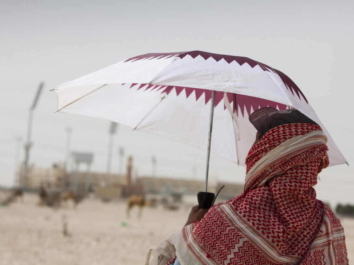 A Nepalese worker observes a construction site outside Doha, Qatar, the host of the 2022 FIFA World Cup. Photo: Frank Rumpenhorst/dpa