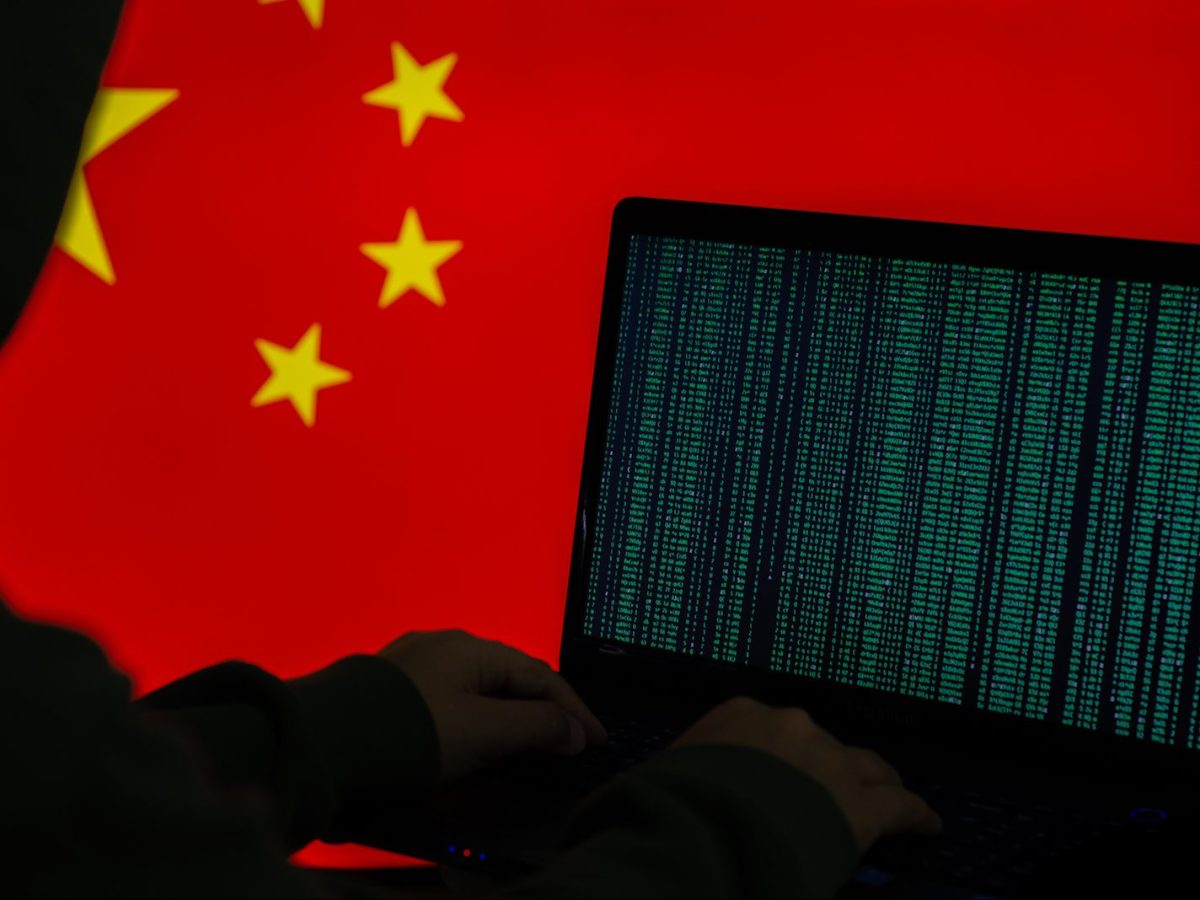 Conceptual image of a computer hacker juxtaposed against a Chinese flag.  Image: iStock/Getty Images