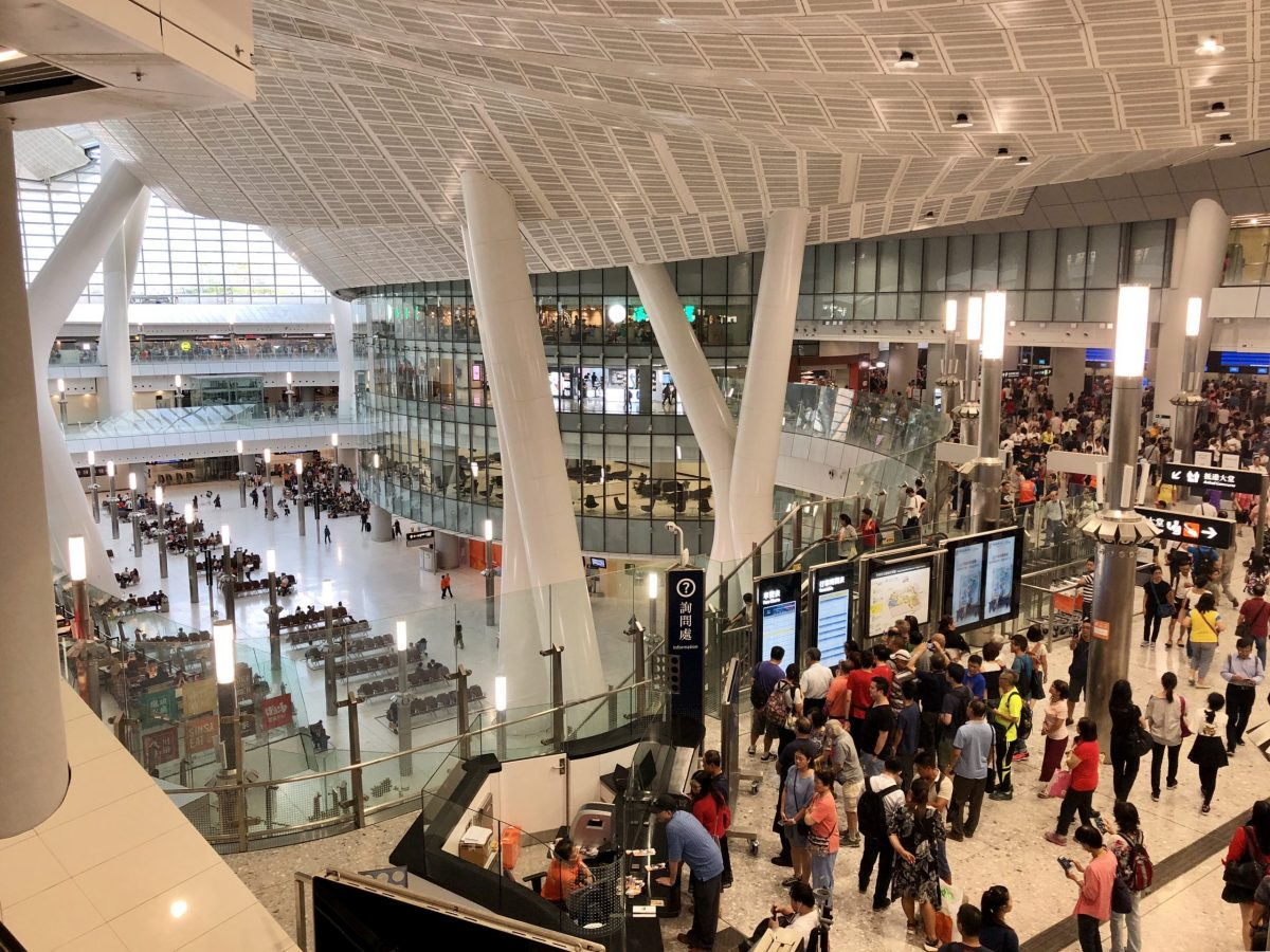 Throngs of passengers inside the West Kowloon Terminus. The station's waiting area (left) is now under the jurisdiction of Chinese laws. Photo: Asia Times
