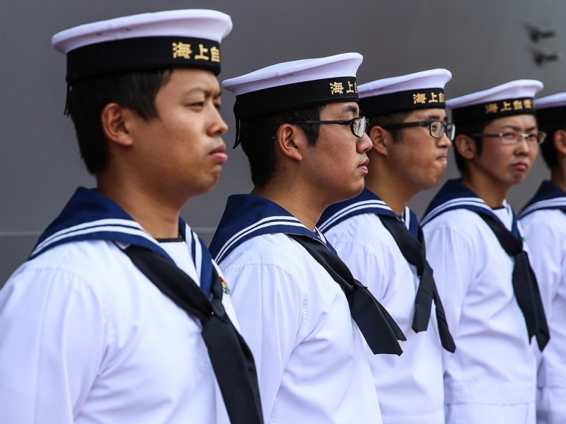 Sailors in the Japan Maritime Self-Defense Force stand at attention aboard the JS KAGA DDH-184 as it arrives at Tanjung Priok port in Indonesia on September 18, 2018. Photo: Andrew Lotulung/NurPhoto)