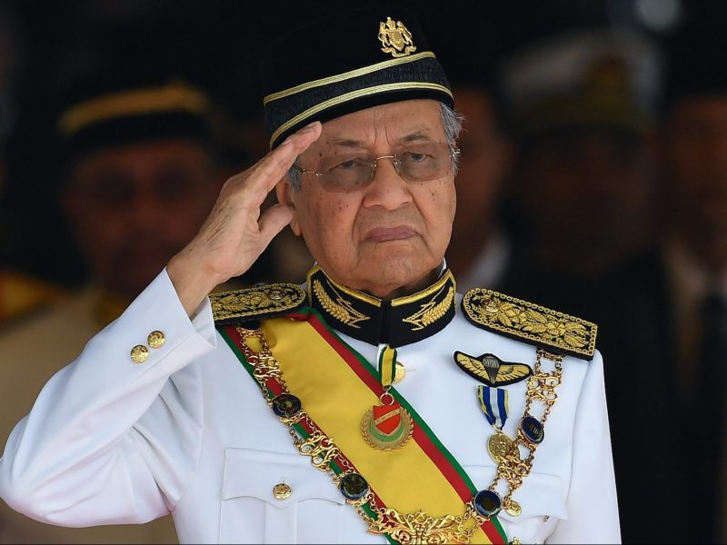 Malaysia's Prime Minister Mahathir Mohamad salutes the royal guard of honor during the opening ceremony of the parliament in Kuala Lumpur on July 17, 2018. Photo: AFP/Mohd Rasfan