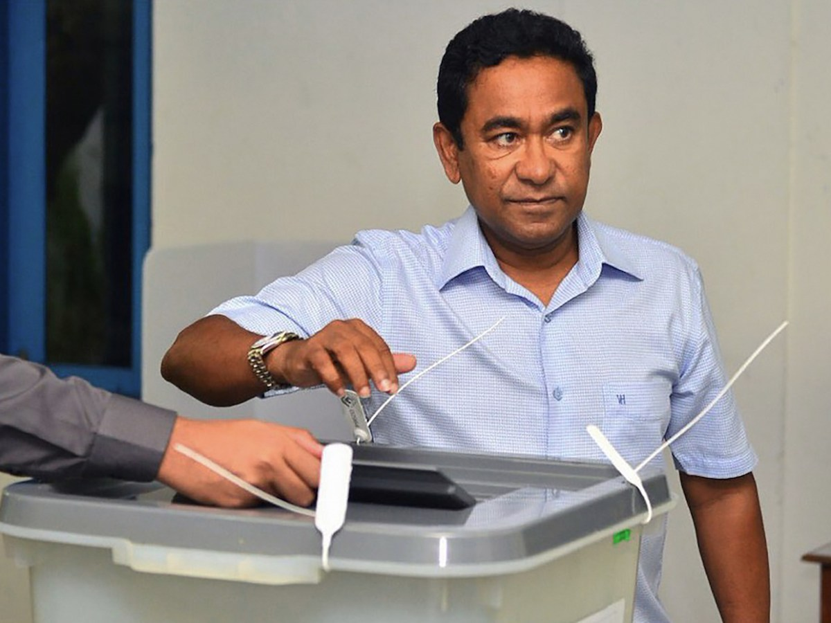 Maldives President Abdulla Yameen votes at a polling station in the capital Male on September 23, 2018. Photo: AFP/Presidential Handout.