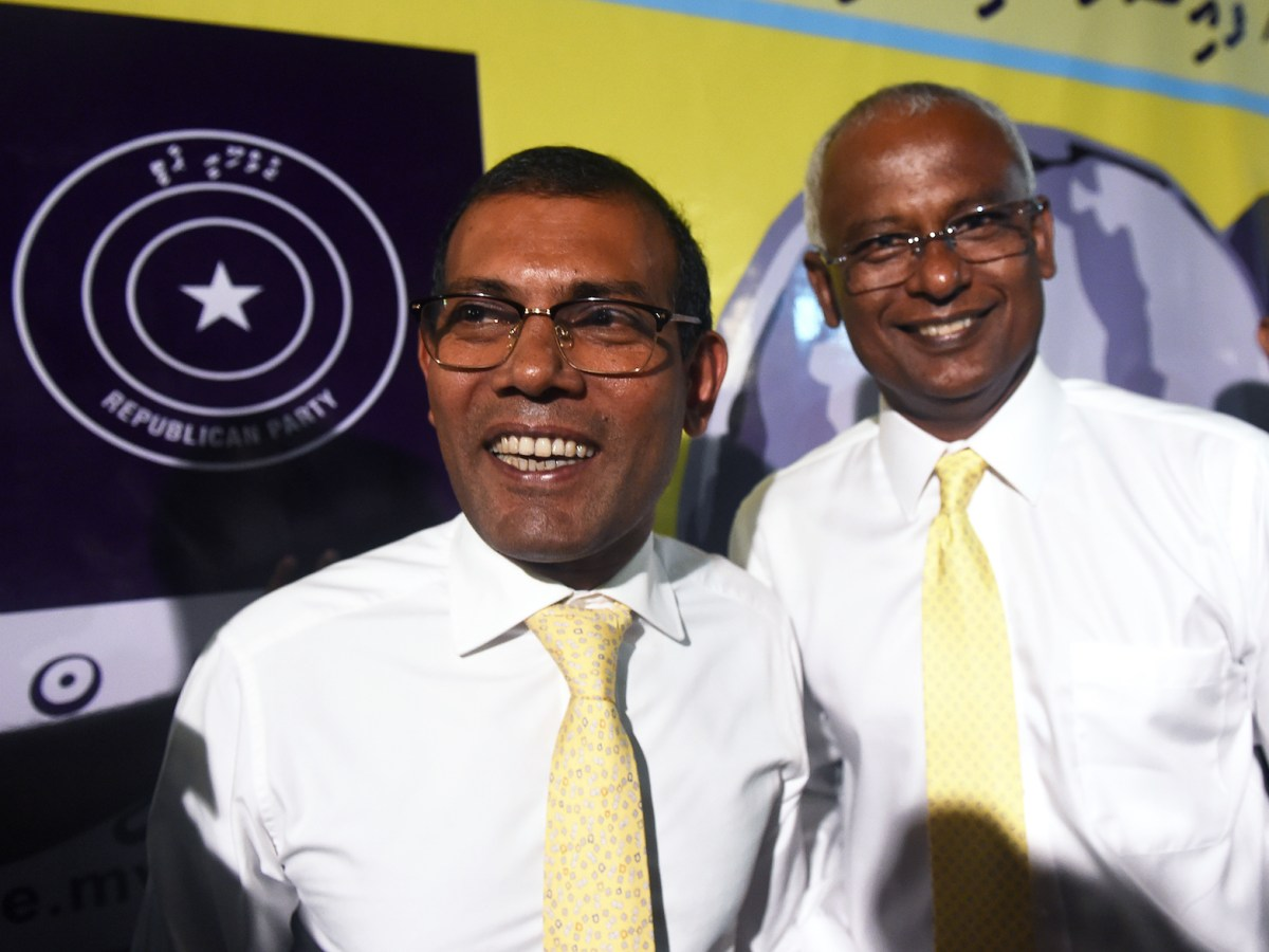 Ibrahim Mohamed Solih (right) and Maldives' self-exiled former president Mohamed Nasheed (left) attend a meeting at Mount Lavinia, a suburb of Colombo, on August 27, 2018. Solih has since been elected president of Maldives. Photo: AFP / Ishara S Kodikara