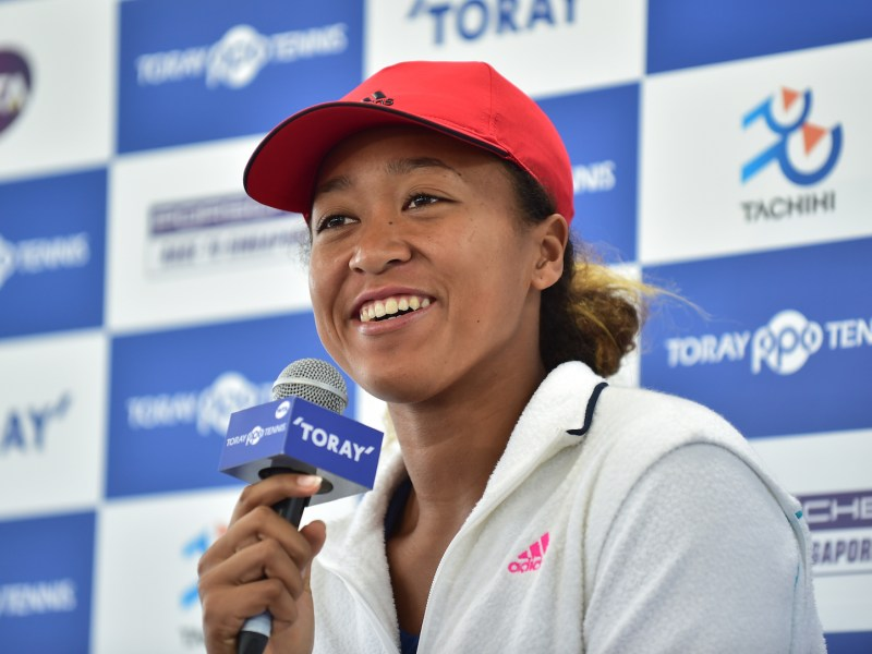 US Open champion Naomi Osaka of Japan answers questions from the media in Tokyo on September 17, 2018. She is one of about 900,000 dual nationals who are meant to decide what country they belong to. Photo: AFP / Kazuhiro Nogi