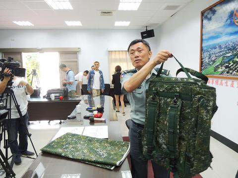 An official with Taiwan's Defense Ministry shows a new backpack designed for the use of infantry regiments. Photo: Taipei Times