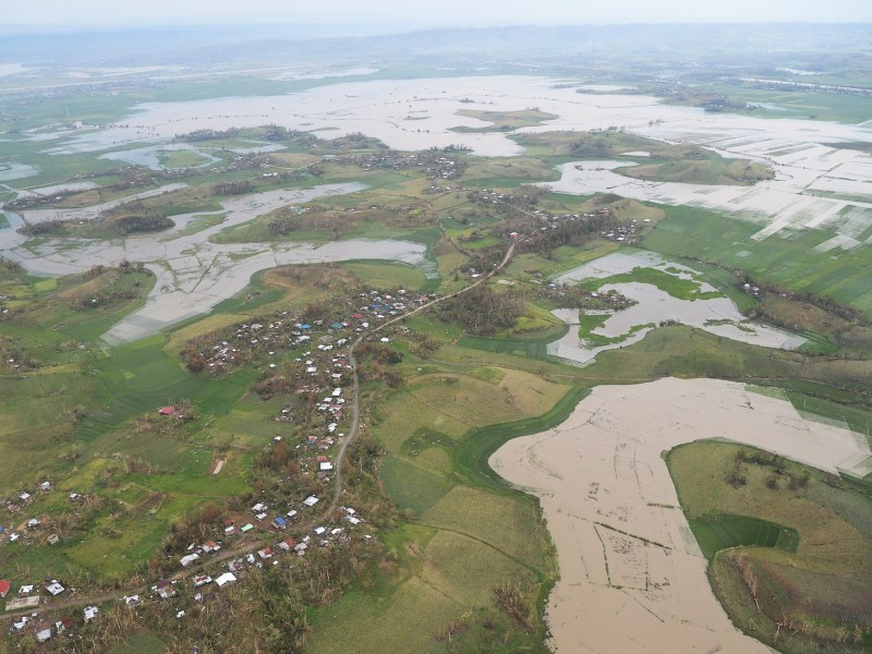 An aerial photo shows devastated homes and rice and corn fields inundated by floods from a swollen river after heavy rains during Super Typhoon Mangkhut in Alcala, Cagayan province on September 16, 2018. Photo: AFP/ Ted Aljibe