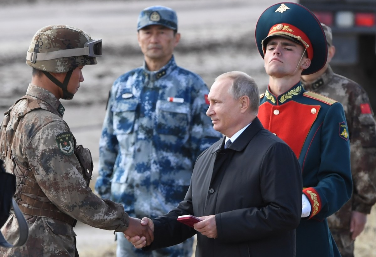 President Putin greets an unidentified Chinese soldier as he reviews troops during the Vostok-2018 military drills at Tsugol training ground in Russia's far east on Sept 13, 2018. Photo: AFP/ Iliya Pitalev/ Sputnik