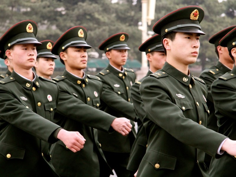 Beijing, China. March 29th, 2013. A group of Chinese military marching across Tiananmen Square.Photo: iStock
