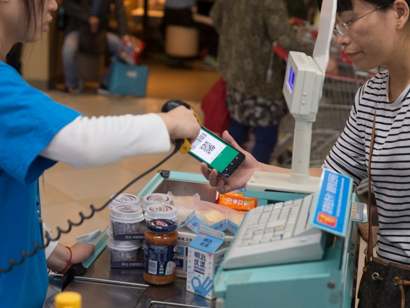 Woman paying with WeChat Pay in a supermarket in Shanghai. Photo: iStock