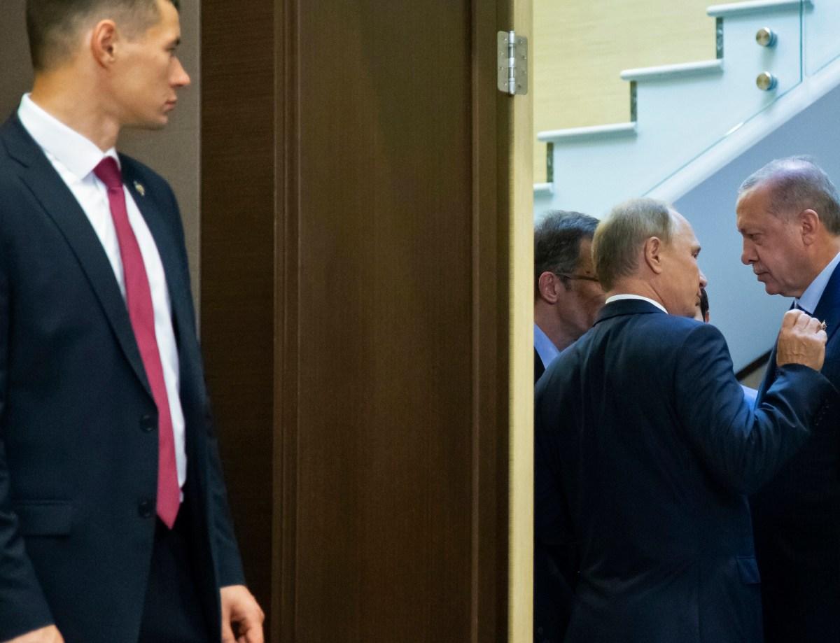 A Russian bodyguard stands near President Vladimir Putin as he talks with Turkish President Recep Tayyip Erdogan during their meeting in the Black Sea resort of Sochi. Photo: AFP/Sputnik/Alexander Zemlianichenko