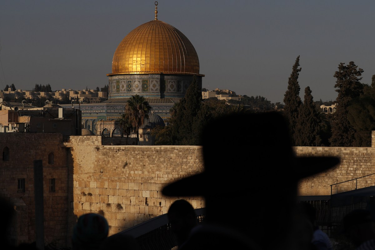 Ultra-Orthodox Jewish men gather near the Dome of the Rock in Jerusalem's Old City. Photo: AFP