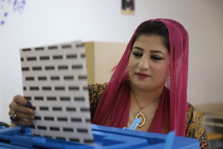 An Iraqi Kurdish woman casts her ballot for the parliamentary election at a polling station in the Iraqi Kurdish city of Sulaimaniyah on Sunday. Photo: iStock