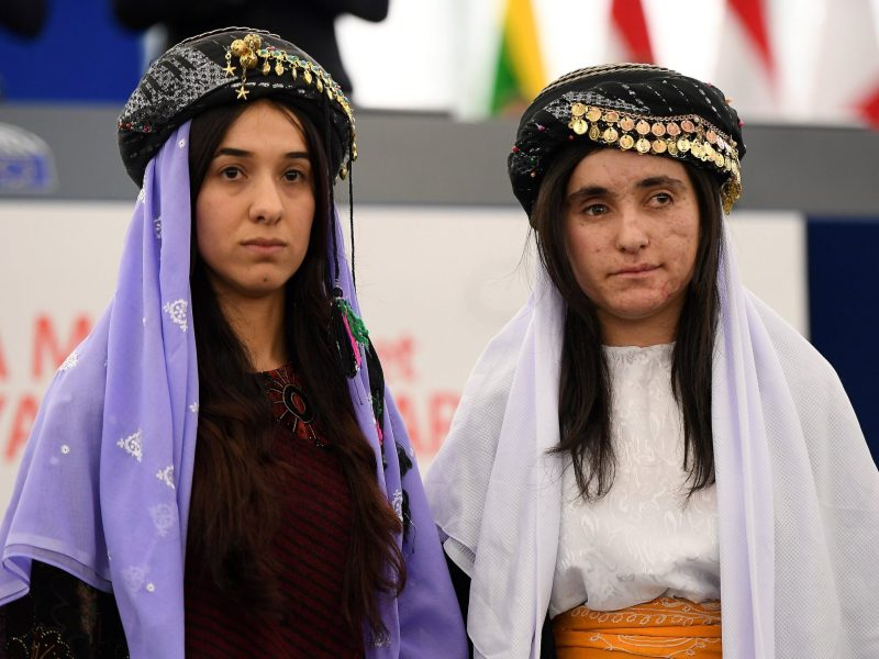 Nadia Murad (L) and Lamia Haji Bashar, public advocates for the Yazidi community in Iraq and survivors of sexual enslavement by the Islamic State jihadists, are awarded laureates of the 2016 Sakharov human rights prize at the European parliament in Strasbourg in 2016. Photo: AFP/ Frederick Florin
