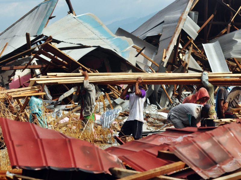 Residents salvage items at the quake-hit Petobo village in Palu following the September 28 earthquake and tsunami that hit the area. Photo:  AFP