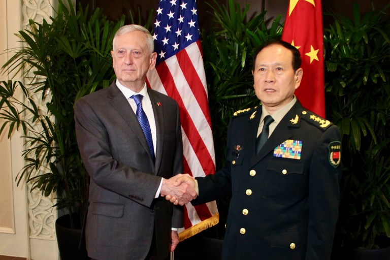 US Defense Secretary James Mattis shakes hands with his Chinese counterpart General Wei Fenghe in Singapore. Photo: AFP
