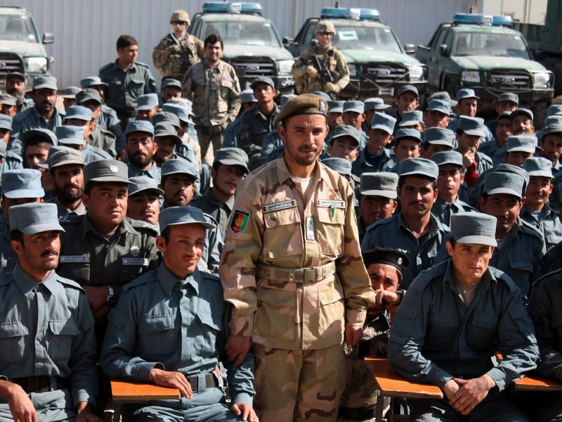 On February 19, 2017, Afghan General Abdul Raziq (C), police chief of Kandahar, poses during a graduation ceremony at a police training center in Kandahar province. (Photo by JAWED TANVEER / AFP)