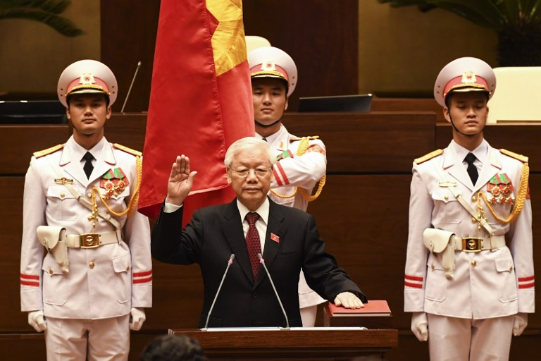 Vietnam communist party chief Nguyen Phu Trong takes oath as country's president at the National Assembly hall in Hanoi on October 23, 2018. - Vietnam lawmakers on October 23, 2018 elected as president communist party chief Nguyen Phu Trong, the only candidate on the ballot, making him the most powerful man in the country where consensus leadership has traditionally kept strongman rule in check. (Photo by - / AFP)